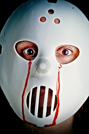 Bloody hockey mask stock photo, Cross processed image of a hockey mask with blood coming from the eyes. by Vince Clements