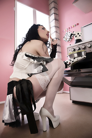 Doll's kitchen stock photo, Model doll dressed try cooking by Luca Mosconi