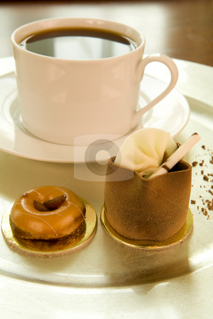 Coffee and chocolate cake on a tray stock photo, Freshly brewed coffee and chocolate mousse cake on a silver tray by Magdalena Ascough
