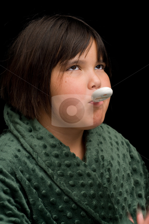 Body Temperature stock photo, A young girl with a thermometer in her mouth by Richard Nelson