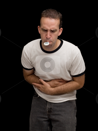 Cramps stock photo, A male holding his stomach in pain and taking his temperature by Richard Nelson