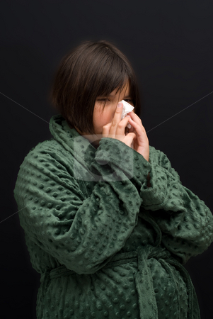 Girl With A Cold stock photo, A young girl with a cold, blowing her nose by Richard Nelson
