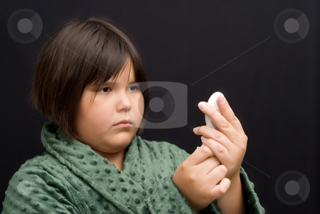 Fever stock photo, A young girl reading the thermometer to see if she has a fever by Richard Nelson