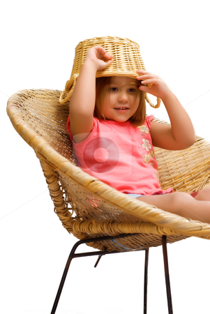 Goofy Kid stock photo, A young girl sitting in a wicker chair, isolated against a white background by Richard Nelson
