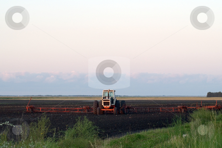 Farm Plow stock photo, A tractor and plow working the soil by Richard Nelson