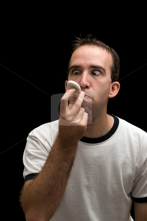 Sick Man stock photo, A caucasian man trying to read the thermometer while still in his mouth by Richard Nelson