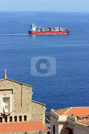 Cantainer cargo ship over Scilla cathedral stock photo, Container cargo ship visible from Scilla (Calabria) over church by Natalia Macheda