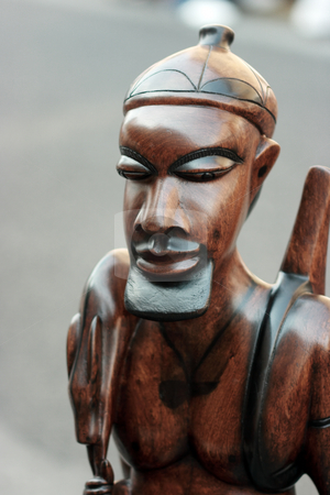 Statue of african hunter stock photo, Traditional wooden statue of african hynter typical for central Africa by Natalia Macheda