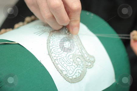 Lace-making stock photo, Process of lace-making with bobbins by Natalia Macheda