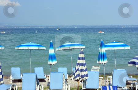 Summertime in Sirmione stock photo, Beach with colorful umbrellas in Sirmione near Garda lake by Natalia Macheda