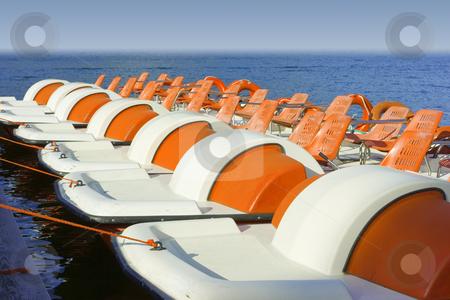 Colorful catamarans on leash stock photo, Row of colorful catamarans floating leashed to quay by Natalia Macheda
