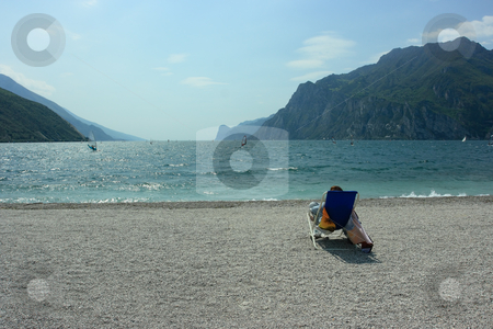 Observing surfers stock photo, Lonely observer looking on surfers on Garda lake by Natalia Macheda