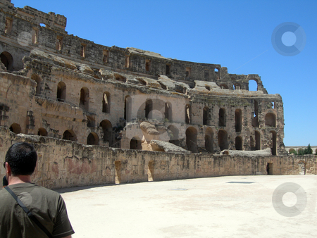 Colosseum of tunisia stock photo, Roman colosseum of tunisia and tourists ancient landmarks of africa by EVANGELOS THOMAIDIS