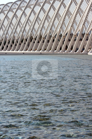 Water focus stock photo, Focus on the water detail from modern metallic stucture of agora olympic stadium athens greece by EVANGELOS THOMAIDIS