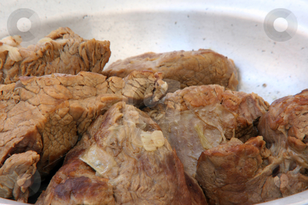 Roast beef stock photo, Preparing dinner roast beef  on dish by EVANGELOS THOMAIDIS