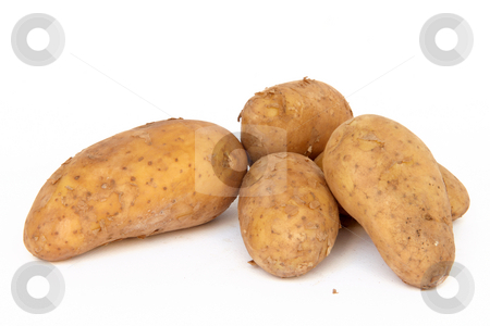 Raw patotes stock photo, Heap raw potatos vegetable root closeup isolated on white background by EVANGELOS THOMAIDIS