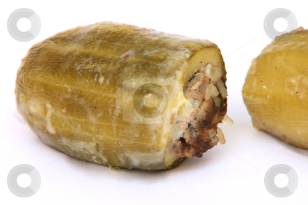 Stuffed courgettes stock photo, Traditional greek cuisine Baked stuffed courgettes isolated on white by EVANGELOS THOMAIDIS