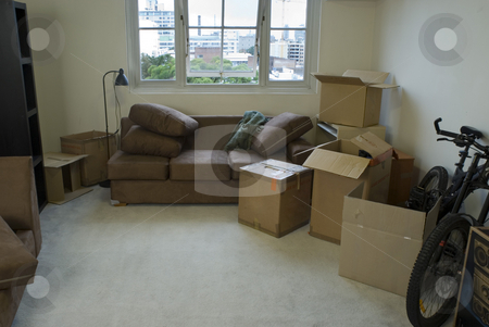 Moving house stock photo, Unpacking boxes after moving into a new apartment by Stephen Gibson