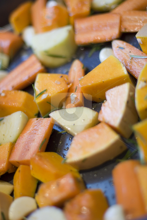 Roast vegetables stock photo, A tray of seasoned winter vegetables ready for roasting by Stephen Gibson