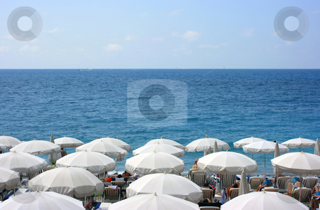 Beach with white umbrellas stock photo, Beach with umbrellas near Promenade des Angles. Nice. France by Natalia Macheda