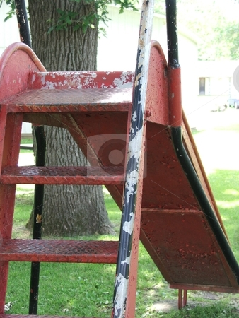 Old Playground Slide stock photo, An old playground slide in a small park playground in Chester, Iowa waits patienly for its next user. by Dennis Thomsen