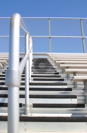Bleachers stock photo, Bleachers in a stadium with the view of some stairs. by Henrik Lehnerer