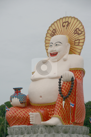 Smiling buddha of wealth stock photo, Smiling buddha of wealth statue at Wat Pai Laem temple in samui island thailand by EVANGELOS THOMAIDIS