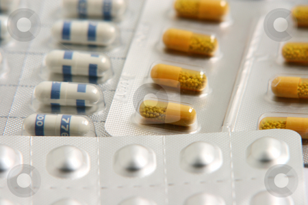 Pills containers stacked stock photo, Pills containers medical concepts by EVANGELOS THOMAIDIS
