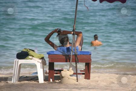 Woman on the beach stock photo, Beautiful woman on sunbed Lamai Beach Koh Samui Island thailand by EVANGELOS THOMAIDIS