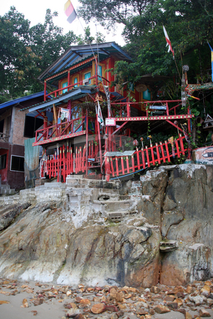 Hippy house stock photo, Colorful hippy house on the rocks koh chang island thailand by EVANGELOS THOMAIDIS