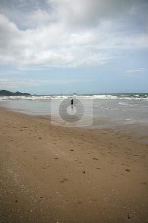 Man walking stock photo, Man walking on white sand beach koh chang island thailand by EVANGELOS THOMAIDIS