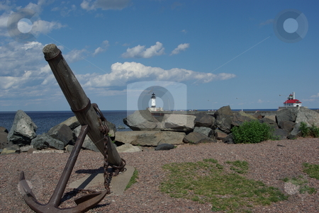 Scenic Duluth shoreline stock photo, Blue sky, white fluffy clouds, lighthouses, Lake Superior and an old ships anchor provide an artistic scene along a sunny section of Duluth, Minnesota waterfront by Canal Park. by Dennis Thomsen
