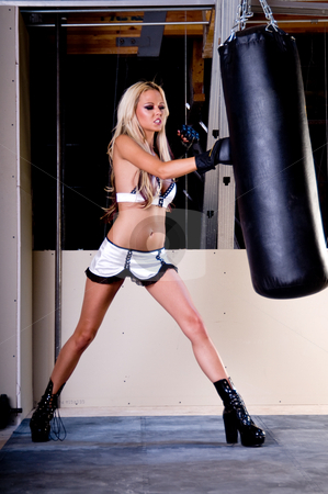 Sexy MMA Fighter stock photo, Sexy blond female MMA fighter training in the gym punching a heavybag by Robert Deal