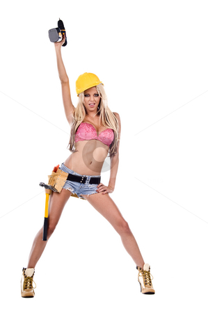 Sexy Construction Worker stock photo, High fashion glamour model in daisy duke shorts, tool belt, pink bra and yellow hard hat on a ladder with a screw gun by Robert Deal