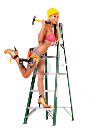 Female Construction Worker in bra stock photo, High fashion glamour model in daisy duke shorts, tool belt, pink bra and yellow hard hat on a ladder with hammer by Robert Deal