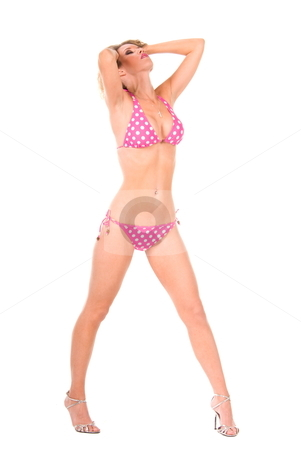 Pink polka dot bikini blond. stock photo, Full length shot of a blond woman wearing a pink polka dot bikini, running both of her hands through her hair. by Robert Deal