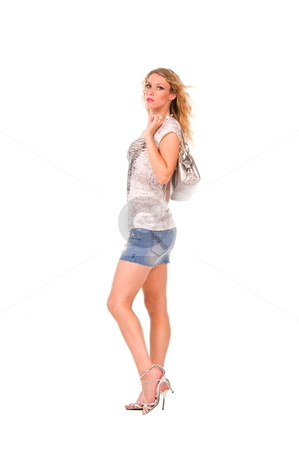Blond woman with silver purse. stock photo, Blond woman wearing a short denium skirt holding a silver purse. by Robert Deal