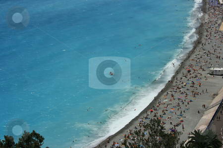 Cote'd'Azur stock photo, Azure color of the Mediterranean sea and touristic beach near Promenade des Anglais in Nice, French riviera by Natalia Macheda