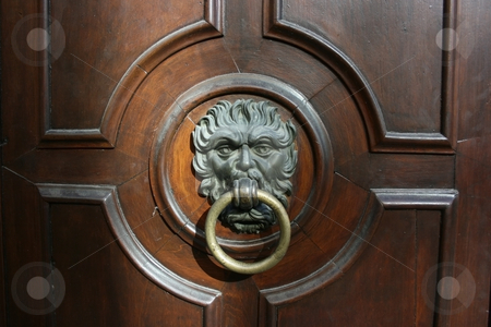 Door knocker stock photo, Impressive iron door knocker on a massive wooden door by Natalia Macheda