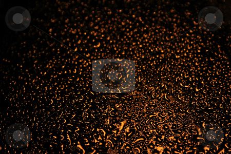 Water Droplets stock photo, Abstract background of water drops on window illuminated by street lamp by Natalia Macheda