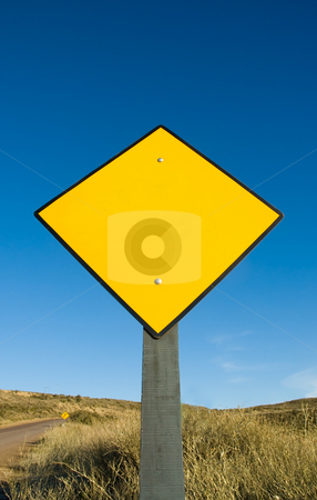 Blank yellow traffic sign. stock photo, Blank yellow traffic sign in a road in Patagonia. by Pablo Caridad