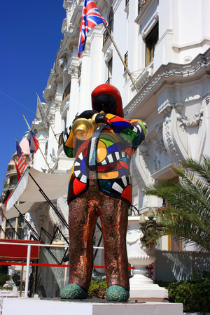 Jazzman statue stock photo, Statue of black jazzman in a vivid attire as a shining colorful mosaic. Nice. France by Natalia Macheda