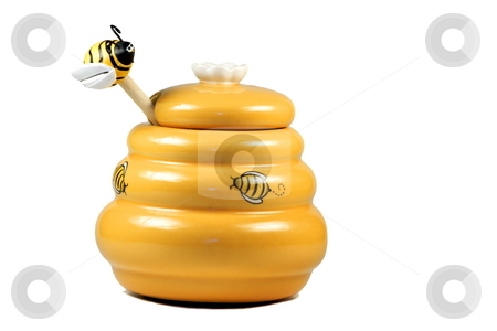 Honey ware stock photo, Funny honey ware of yellow color and depicted bees with a wooden stick ending with a funny figurine of bee isolated over white by Natalia Macheda