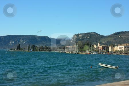 Garda Lake stock photo, Lake Garda coast and mountains on horizon by Natalia Macheda