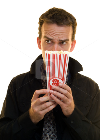 Unhealthy Snack stock photo, A corporate employee hiding behind his popcorn by Richard Nelson