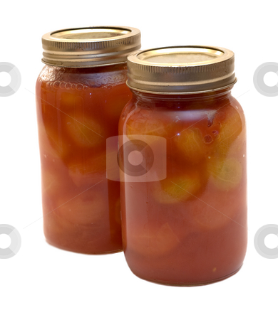 Canned Tomatoes stock photo, Two mason jars filled with canned tomatoes by Richard Nelson