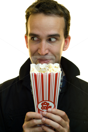 Snack Time stock photo, A businessman grinning and holding a container of popcorn by Richard Nelson