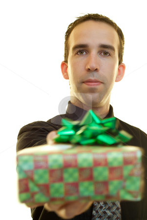 Businessman With Present stock photo, A young businessman holding a wrapped present, isolated on a white background by Richard Nelson