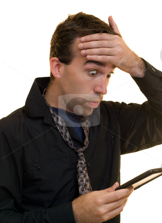 New Accountant stock photo, A new accountant is shocked and confused at his calculations by Richard Nelson
