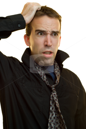 Stressed Businessman stock photo, A young businessman pulling his hair with stress by Richard Nelson
